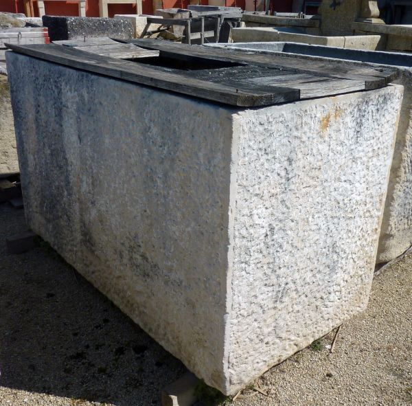 Large rectangular basin made of white stone and wood - antique trough..