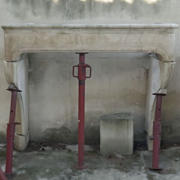 Beautiful antique fireplace - Elegant geometric mantle in natural stone.