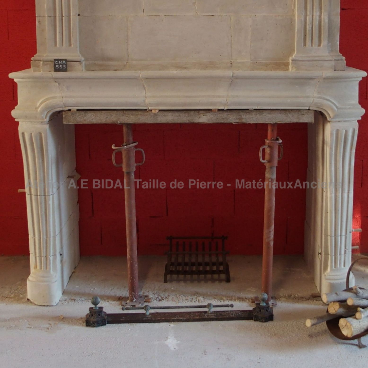Old fireplace - a fireplace with overmantle and made of decorated fine stone.