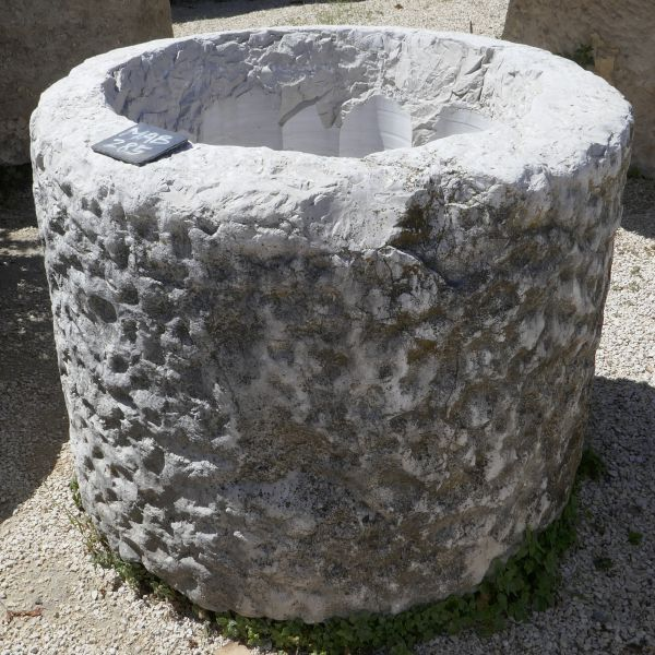 Old stone trough : a circular basin carved by an master craftsman.