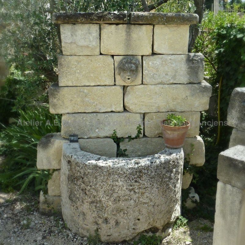 Wall fountain with a very rural character for an authentic garden decoration | Atelier Alain Bidal in Provence.