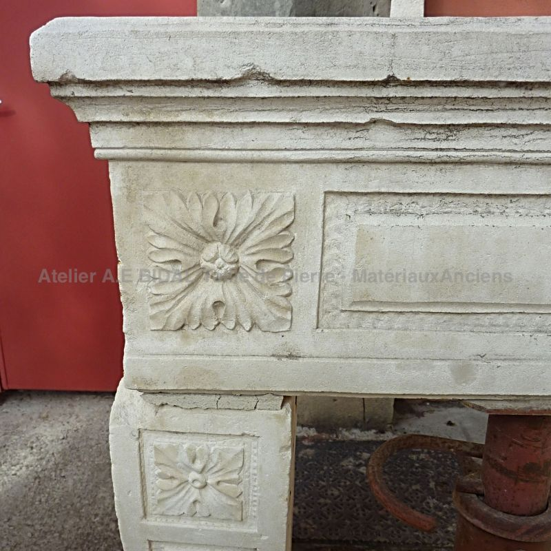 Stone fireplace with decorations on the jambs - Louis XV, Louis XVI stone fireplace .