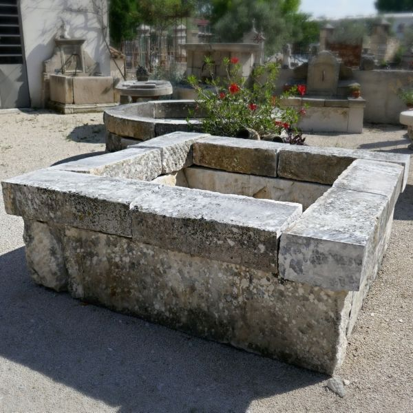 Old stone garden pond on sale at Alain Bidal Antique Materials in Isle sur la Sorgue in Provence.