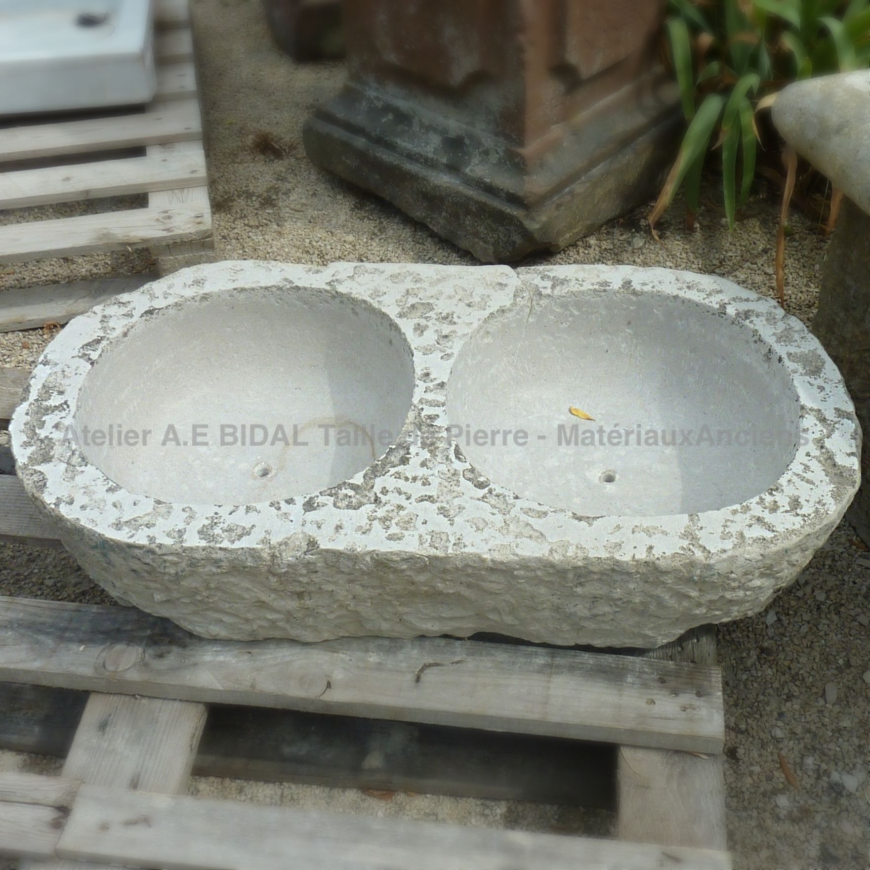 Double washbasin - ancient stone sink with 2 round bowls.