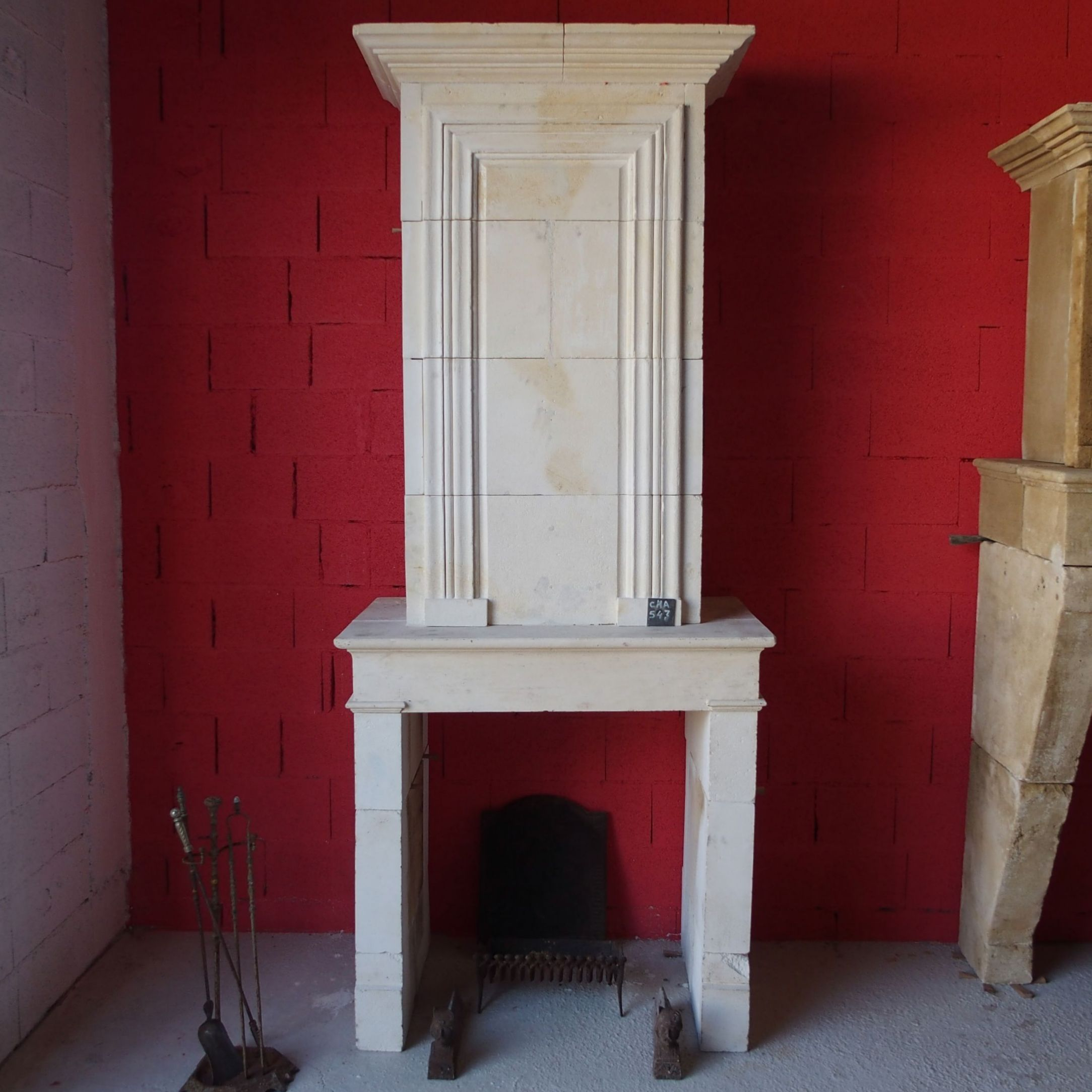 Old fireplace made of white stone in a perrfect color  - old  antique 19th century fireplace.