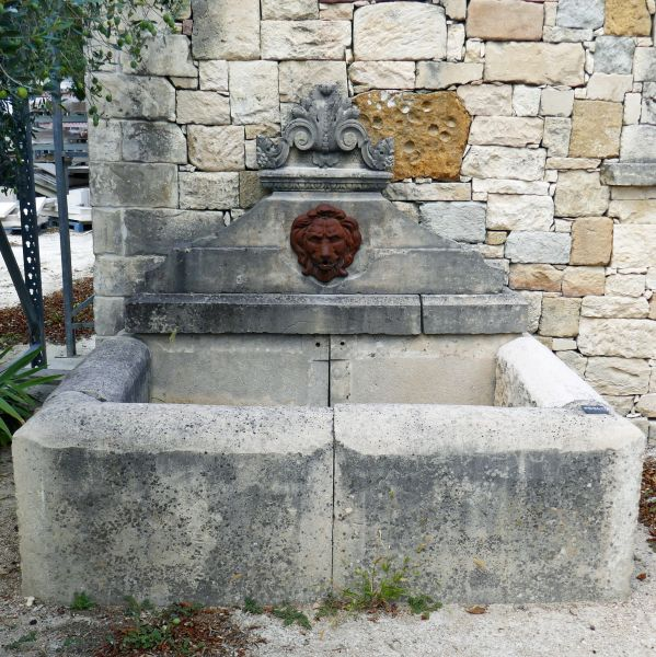 Wall fountain made of stone and cast iron | Fountain of Provence in reclaimed elements from the South of France.