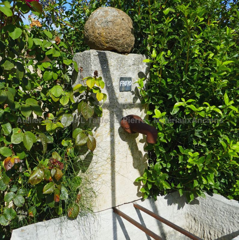 Detail photo of our antique garden fountain in stone by Alain Bidal Antique Materials in Provence.