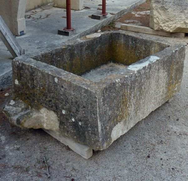 Sale of old stone troughs at Alain Bidal in Provence.