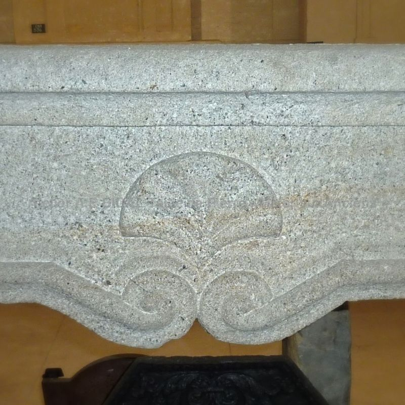 Beautiful decoration on our ancient Louis 15 fireplace made of granite.