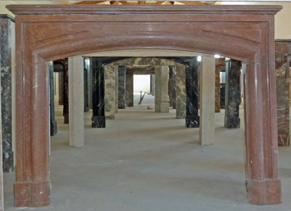 Red marble fireplace - a 19th century fireplace decorated with moldings.