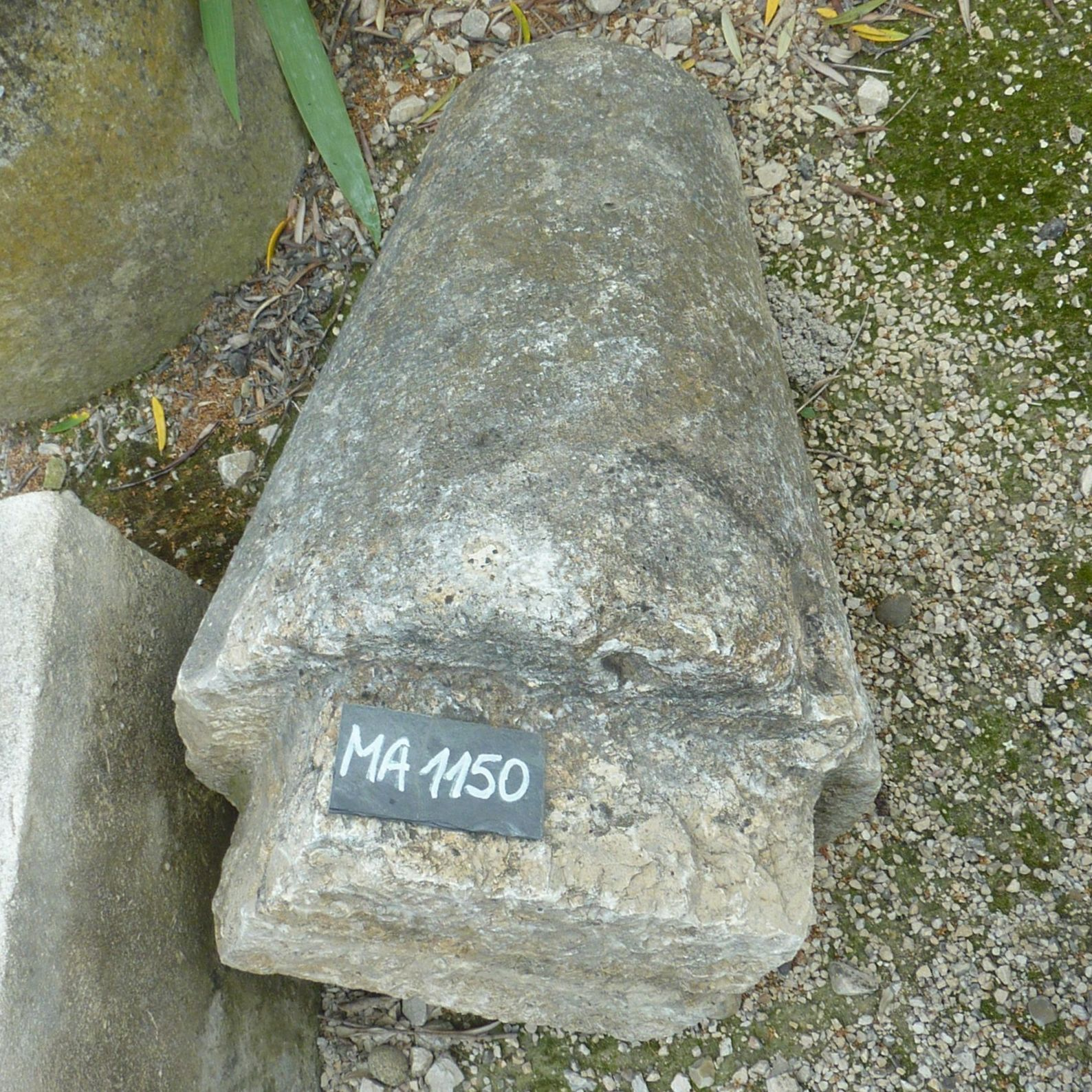old conical marker -craft marker made of monolith stone.