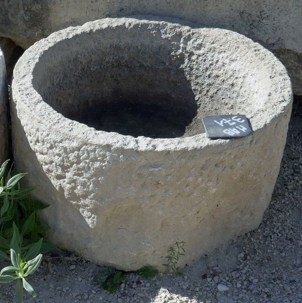 Small antique round trough in stone - Shallow stone trough ideal as a rusticly charming planter.