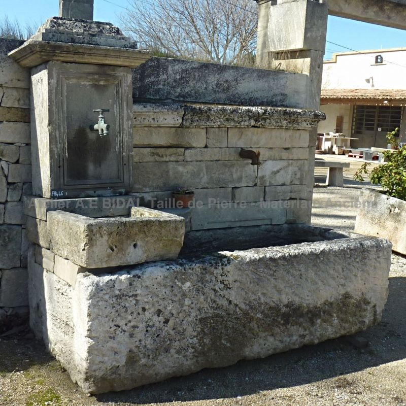 Antique fountain in stone for sale | Provencal fountain in old stones with a very large antique stone trough.