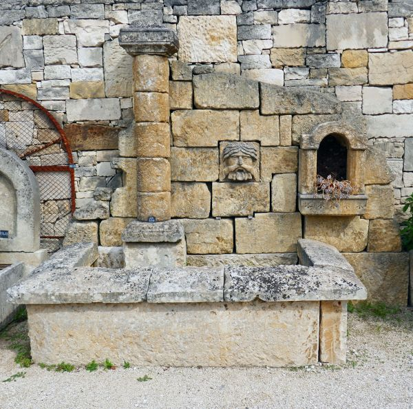 Stone wall fountain - garden fountain with original tray at wall fountain format.