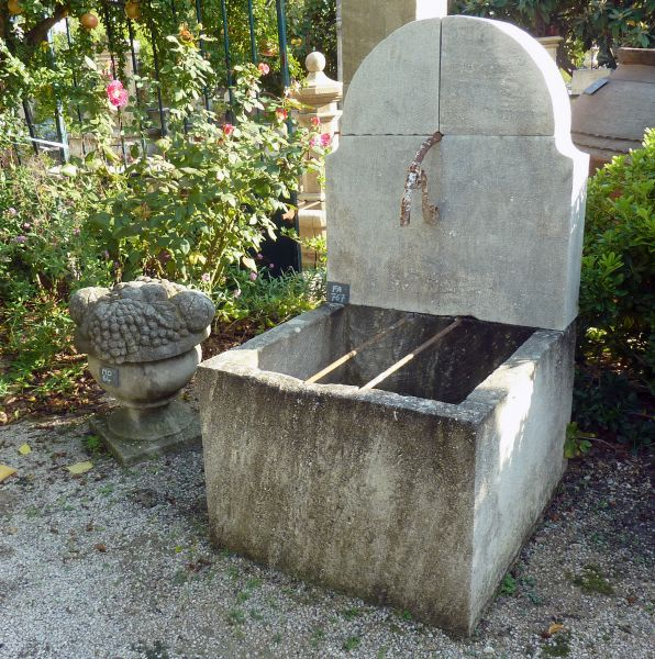 Beautiful garden wall fountain | Outdoor fountain with stone trough | Cheap fountain in stone for garden's layout.