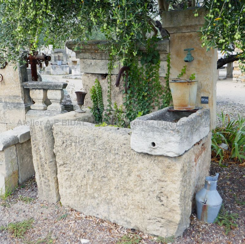 Wall fountain with a rustic look | Garden fountain with two massive troughs and a stone pediment.