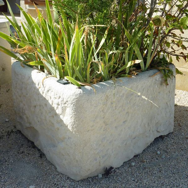 Beautiful rectangular trough : an antique stone trough of rustic style..