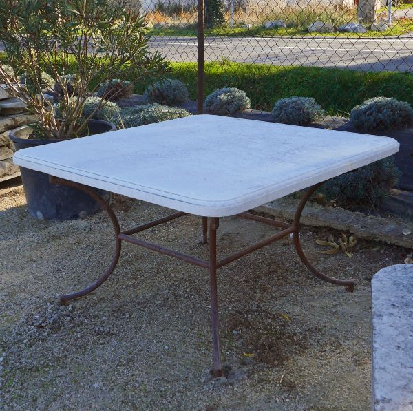 Outdoor stone and iron table - Designer garden furniture by Alain BIDAL Antique Materials in Provence.