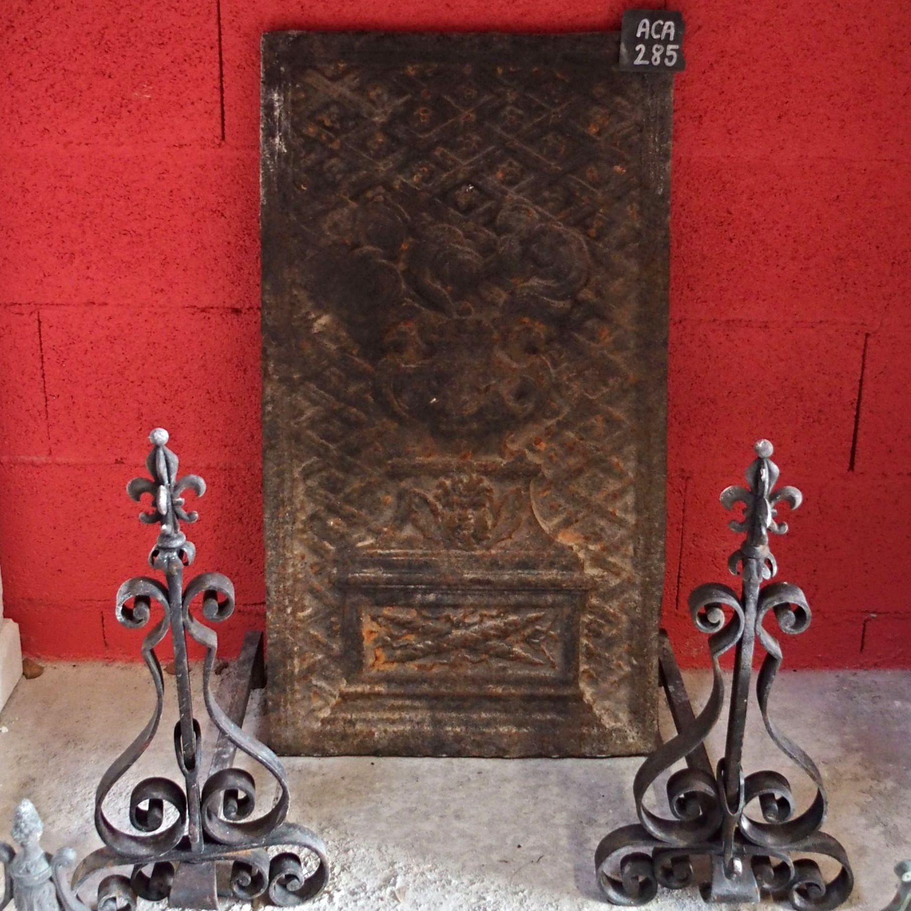 Cast iron fireback- one of the fireplace  accessories of our catalogue of  Provence style crafmade decorative items  made of old materials.