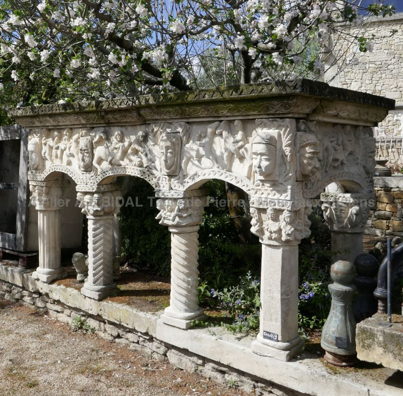 Antique stone fireplace with sculpted columns - white stone fireplace.