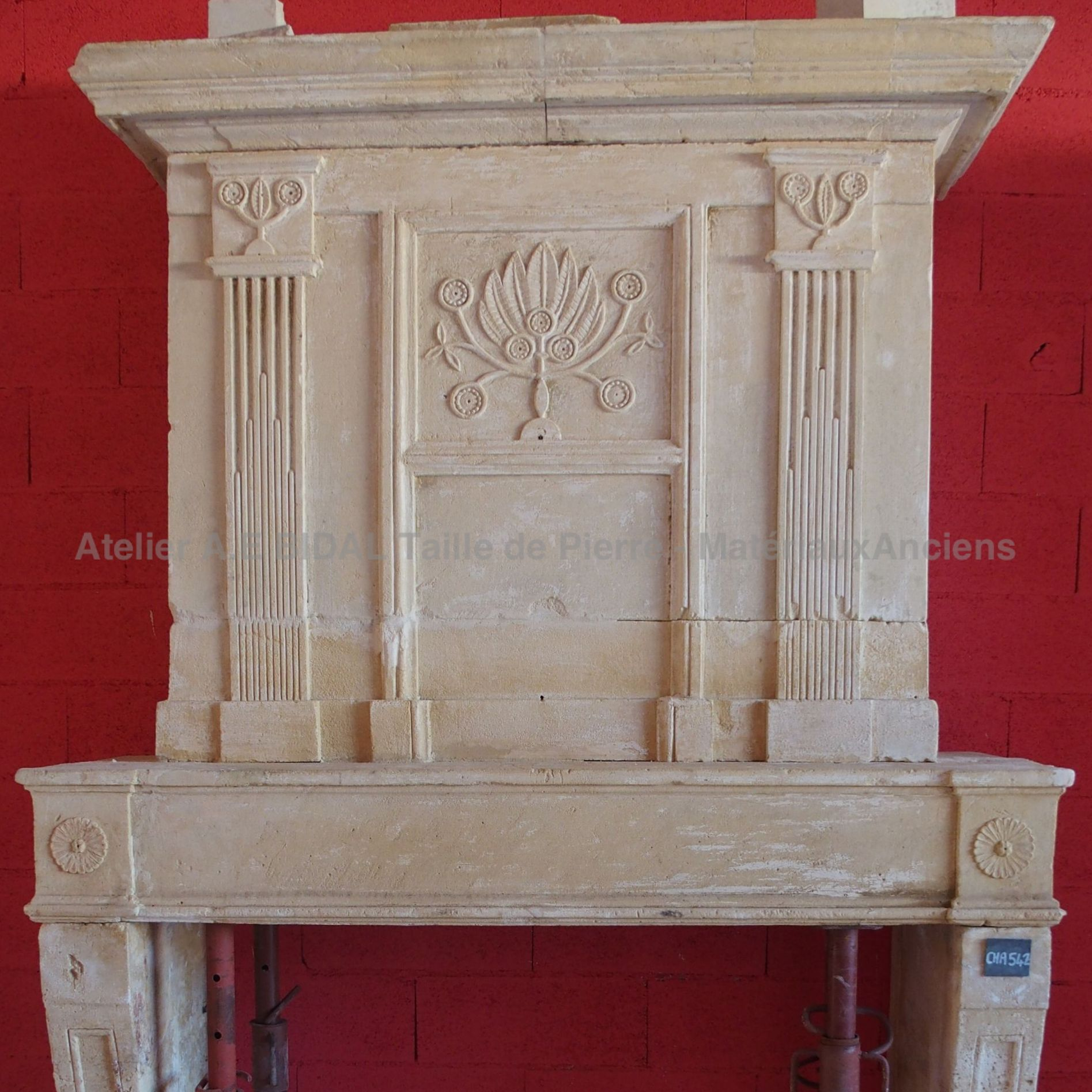 Louis XVI fireplace - an old fireplace in Louis XVI style made of stone.