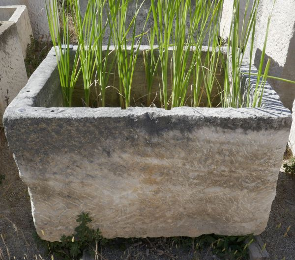 Beautiful trough made of rustic stone - large rectangular basin that can be used as a planter, for example.