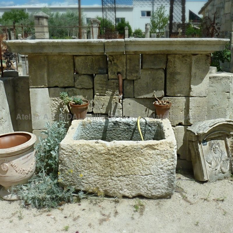 Antique fountain with stone wall and farmer's trough | Decorative garden fountain for sale in Provence.