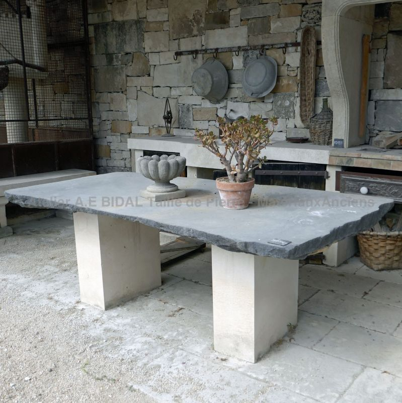 A table for 10 guests, made of old materials.