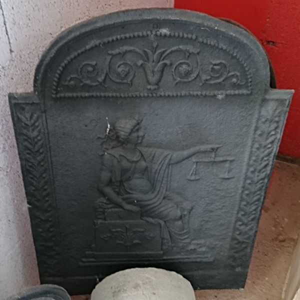 Beautiful old cast iron fireback - our old fireplace accessories.