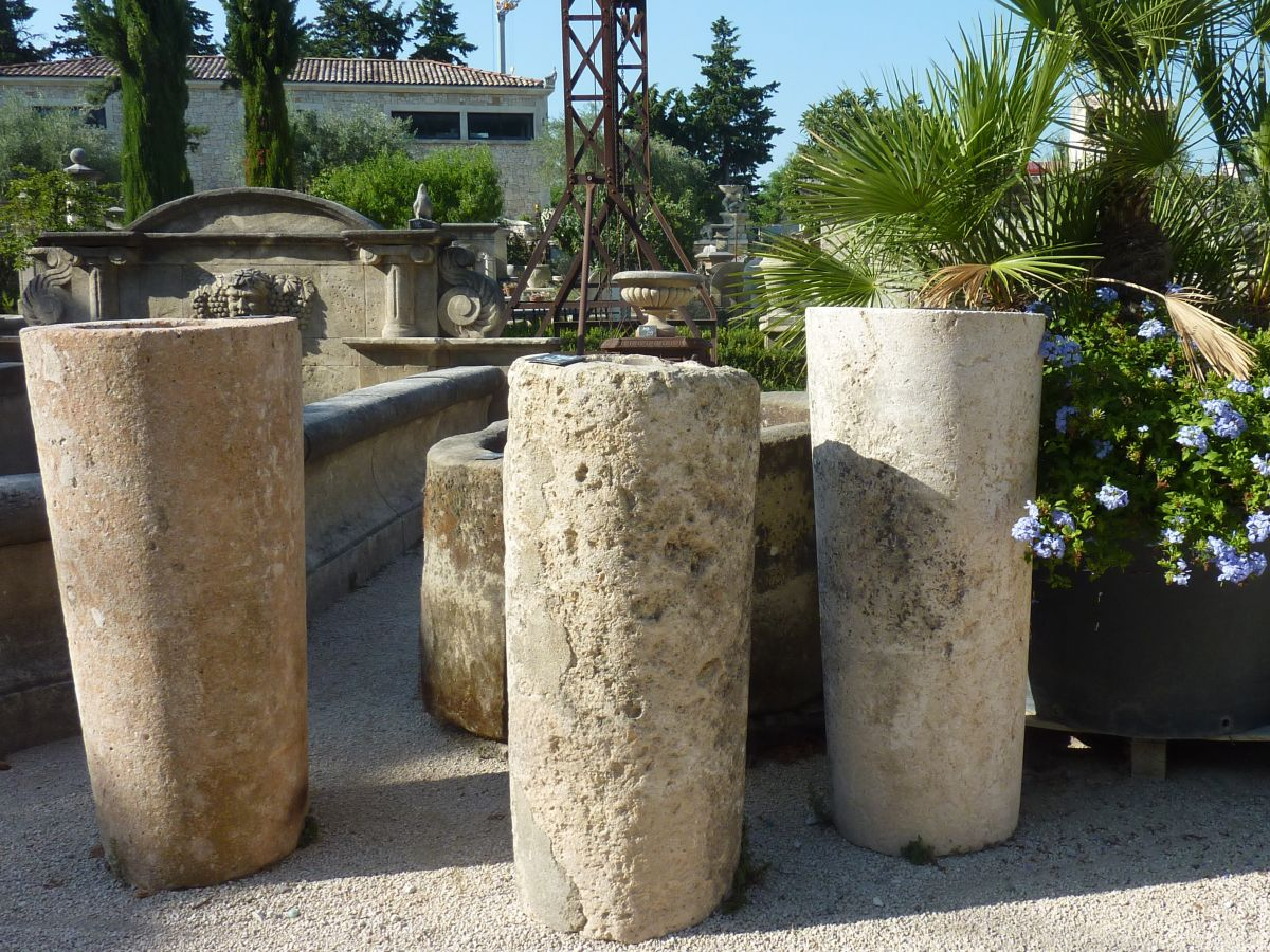 Antique round troughs in stone