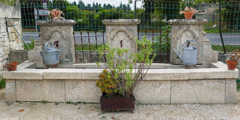 Decorative stone fountain by the artisan stonemason in Provence Alain Bidal.