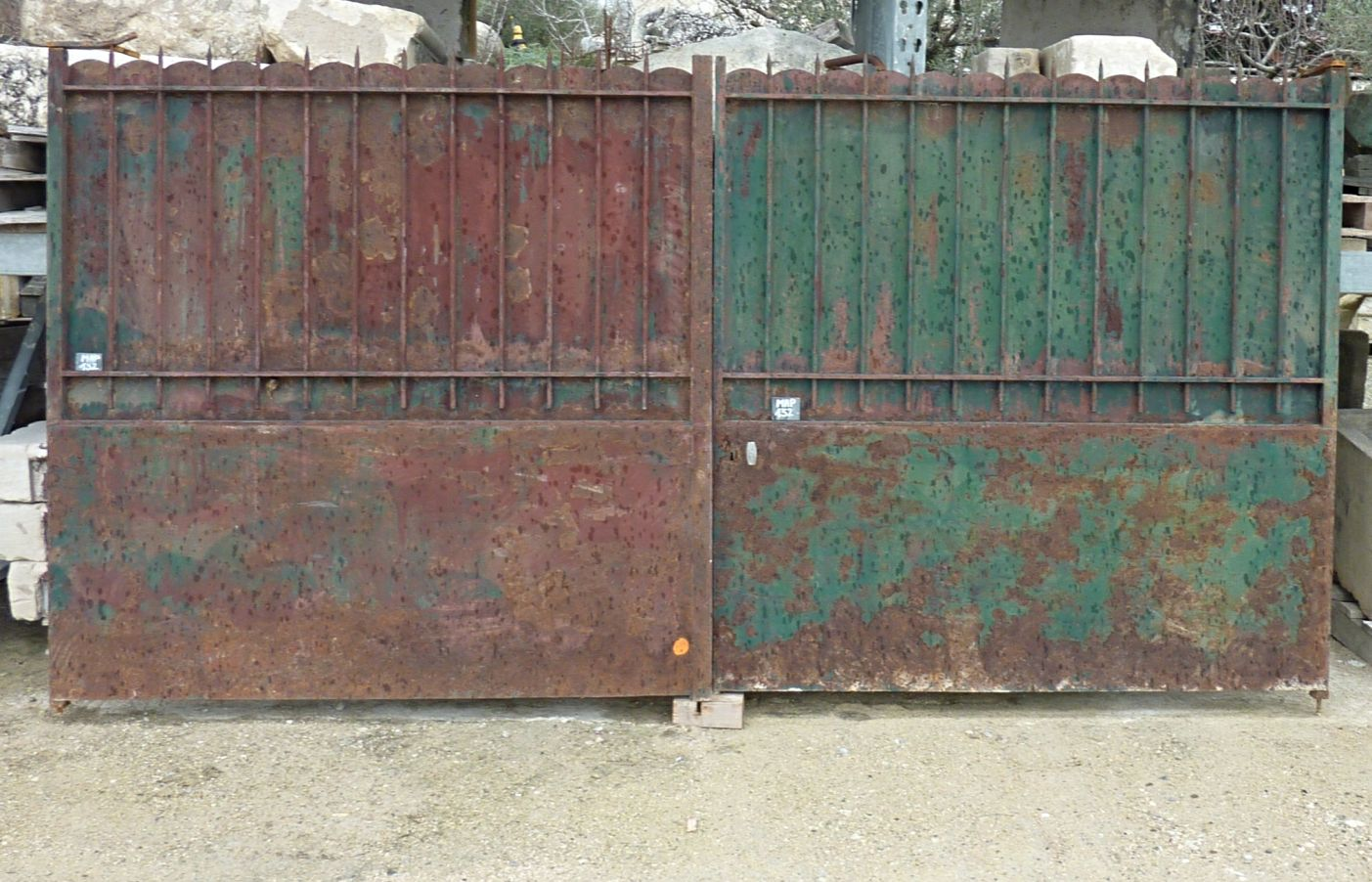 Antique wrought-iron gate with two paneled doors