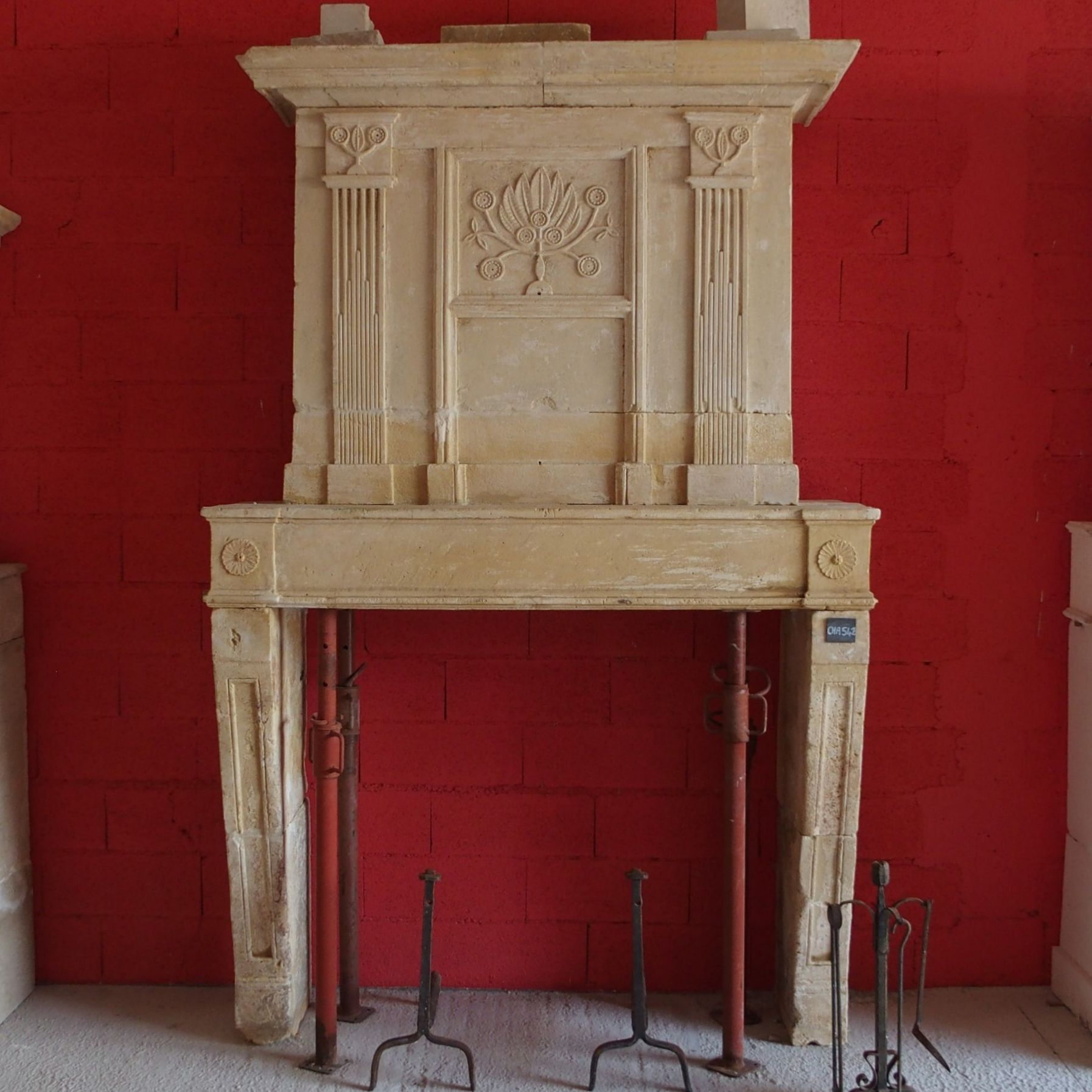 Louis XVI fireplace - a fireplace with overmantl made of Charentes natural stone.