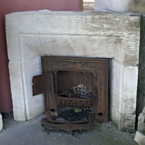 Old fireplace whose size is perfect to decorate and to heat a room - fireplace in stone from long ago.