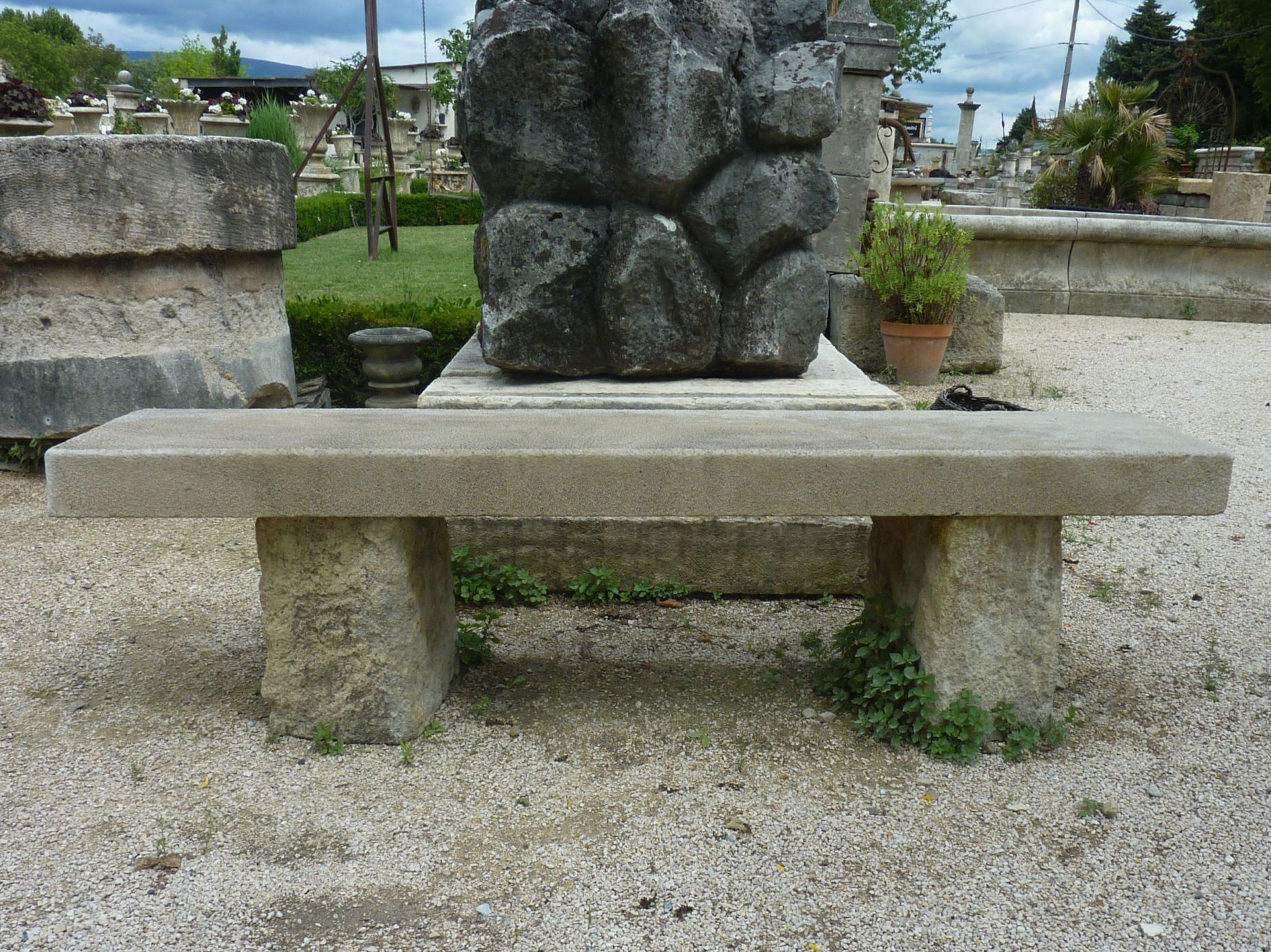 Large limestone bench with massive jambs - old garden furniture.