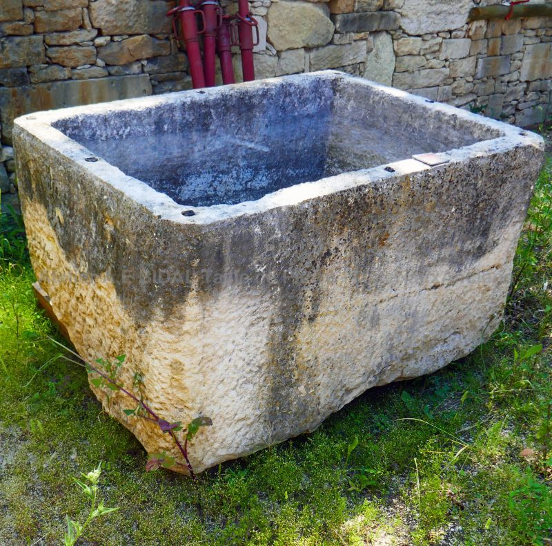 Large massive stone trough as outdoors decoration by Alain Bidal, antique materials in Provence.