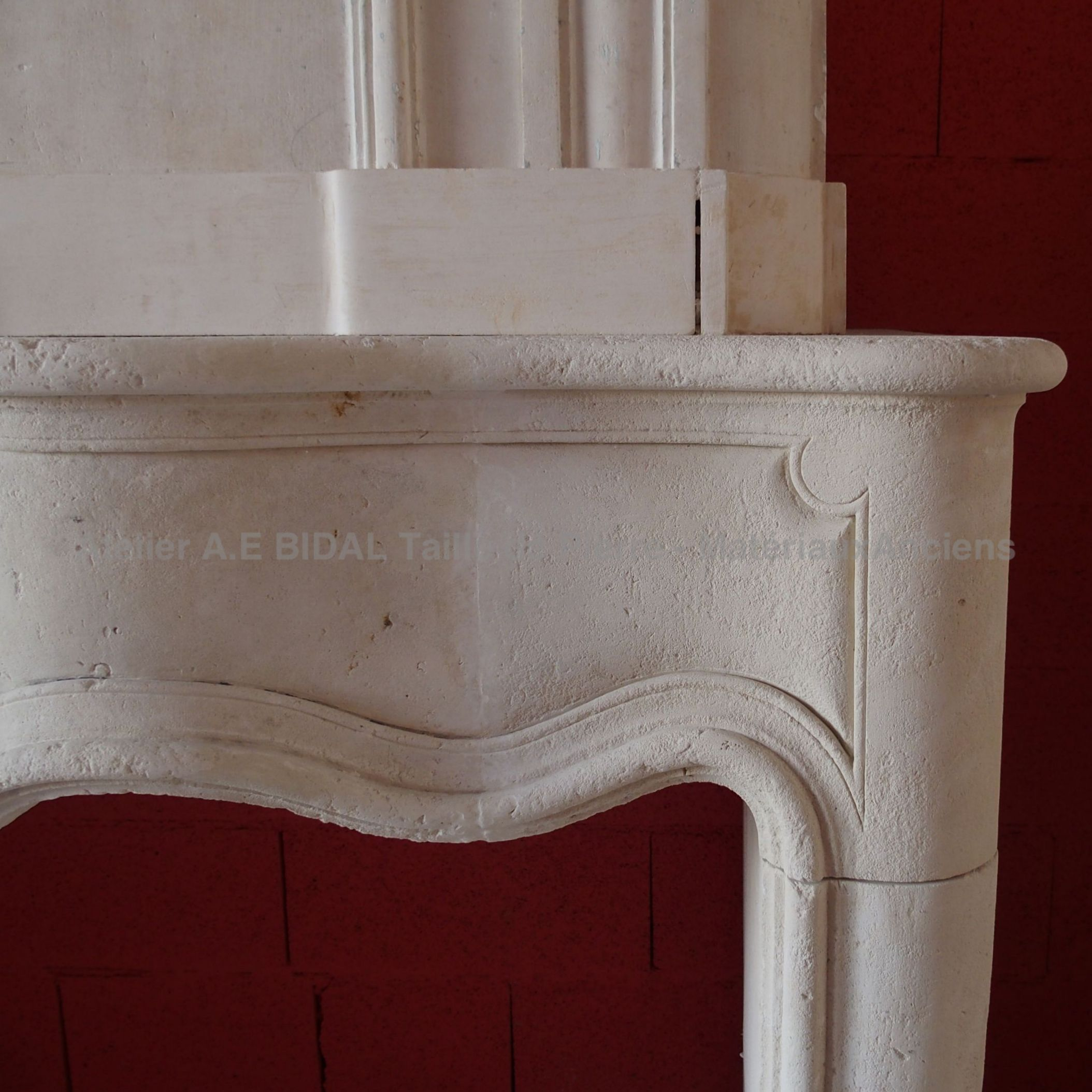 Fireplace made of white stone - French traditional antique fireplace.