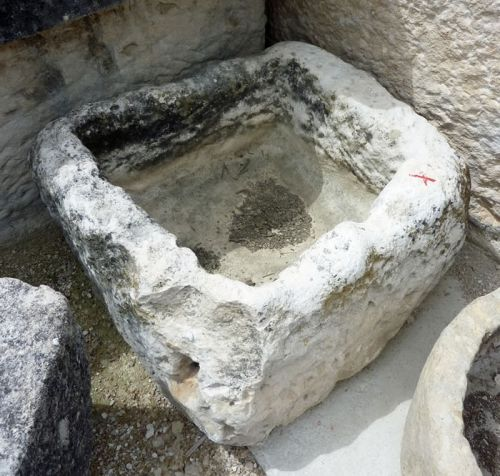 Stone basin - a small old square-shaped stone basin.