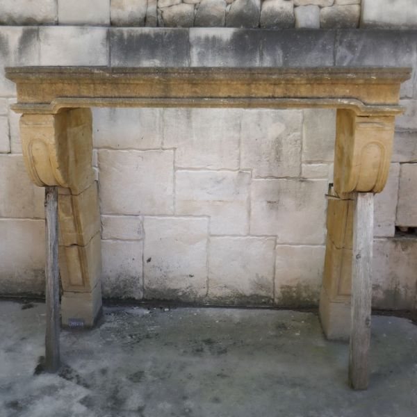 Beautiful yellow stone fireplace - antique fireplace whose lintel is not the original lintel.