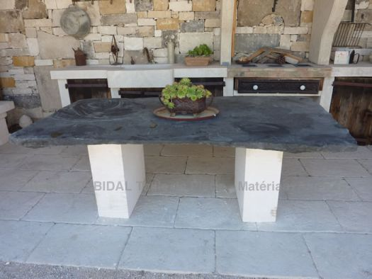 Made of old materials: beautiful two-tone table made of black granite and white stone.