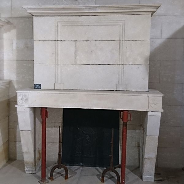 Fireplace with overmantle - elegant stone fireplace from the 18th century.