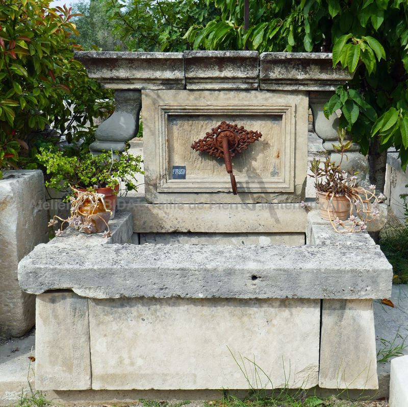 Large fountain in stone from Provence | Garden wall fountain for a rustic garden decoration.