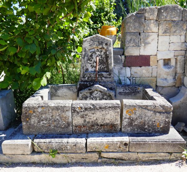 Small stone fountain with poetic notes - wall fountain.