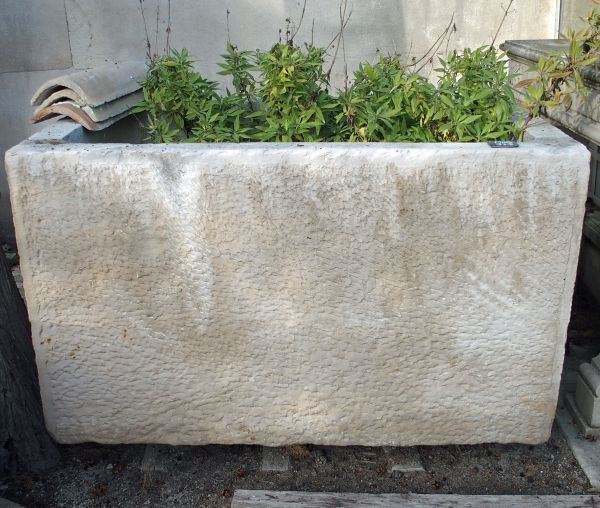 Antique trough in stone : deep stone basin that may be suitable to grow a tree.