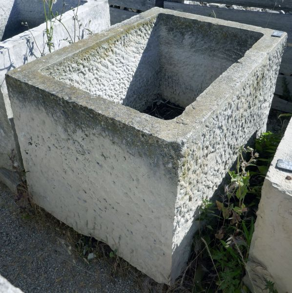 Stone trough as rustic flower pot or sturdy stone planter- rectangular basin.