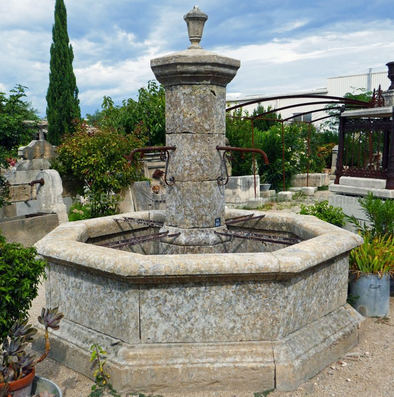 Central fountain made of reclaimed materials - An outdoor fountain with an octagonal basin.