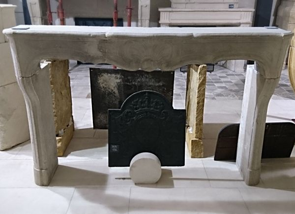 "Old fireplace made of white hard stone - an old fireplace called ""Regency""."