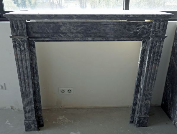 Antique grey marble mantle for sale at Atelier Alain Bidal Antique Materials in Provence.