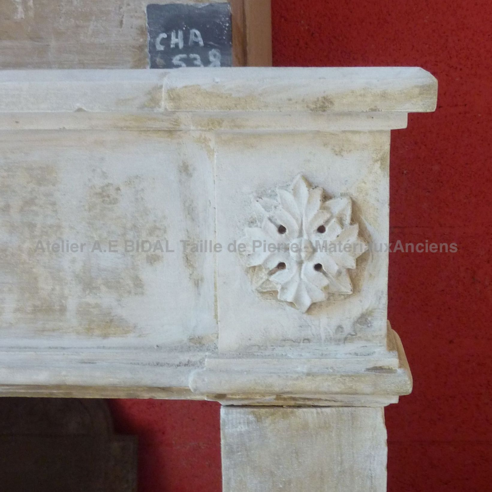 Old fireplace decorated with moldings. It was decorated with care by an old stonemason.