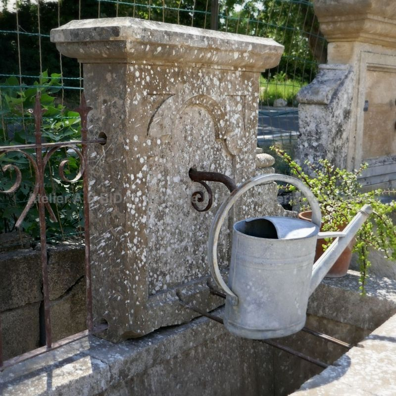 Antique garden fountain in stone for sale in Provence at Atelier Alain BIDAL.